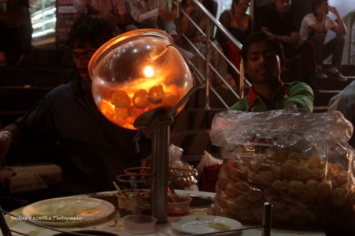Durga Puja is a favourite time for people to gorge on street food. Here is a gol gappa stand near a pandal